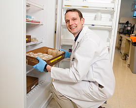 scientist getting samples from the freezer