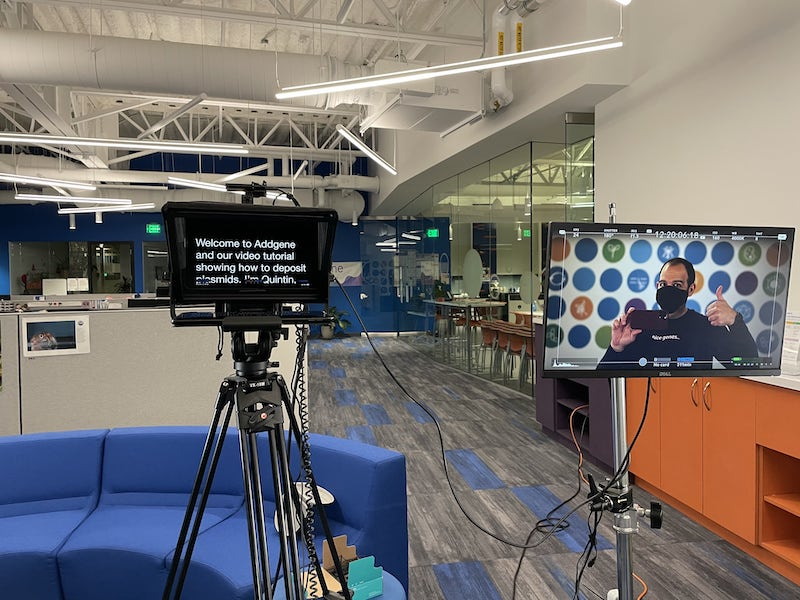 Video set up with teleprompter and monitor for a one-person video shoot.
