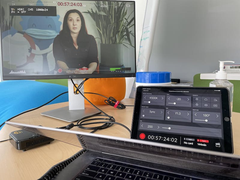 The video monitor showing the talent speaking on camera in the other room.