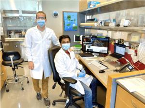 photo of Abhi Aggarwal and Kasper Podgorski in the lab