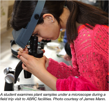 Student Examining Plant sample under .a microscope at ABRC